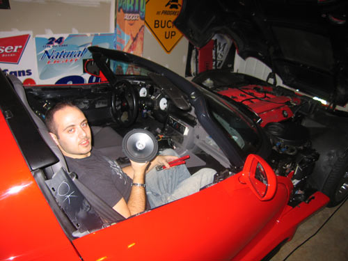 Dave working on install speakers in Dodge Viper