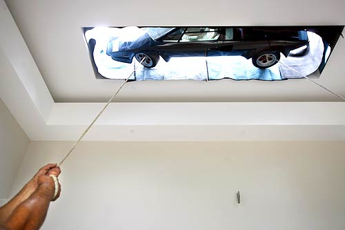 Countach being mounted on wall