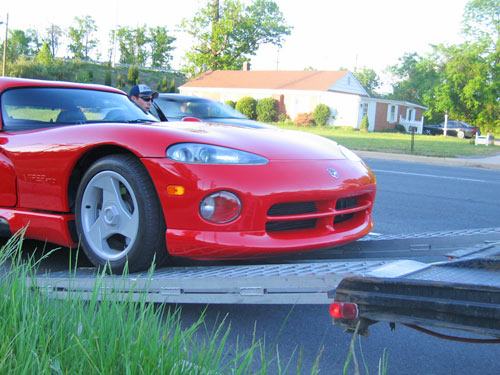 Not much clearance for a Dodge Viper getting off a trailer